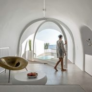 Hotel on the Santorini coast has rooms in white-painted caves