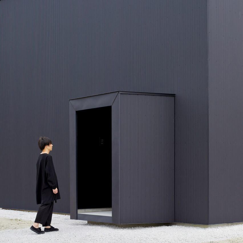 Atelier Kento Eto designs minimal black house hiding lofty interiors
