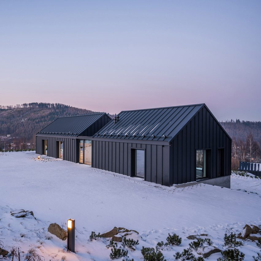 Mountain house in Poland has glazed cut between gables