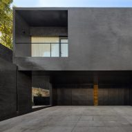 Black facades contrast pale interiors in Lluvia house by PPAA