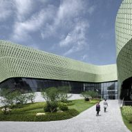 Pale green ceramic tiles cover exhibition centre in China