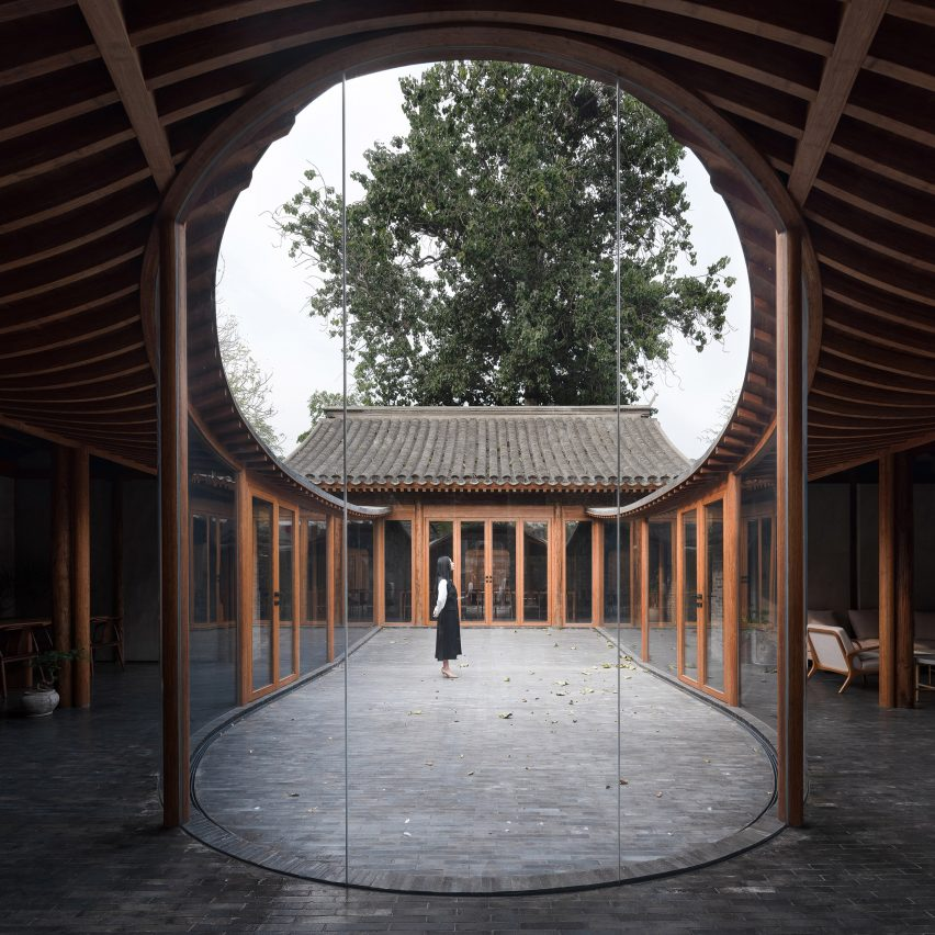 Curving glass walls bulge into courtyards of converted Beijing hutong