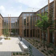 Timber health centre surrounds courtyard of medicinal plants