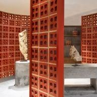 Renesa uses terracotta-brick walls to carve up interiors of Indian showroom