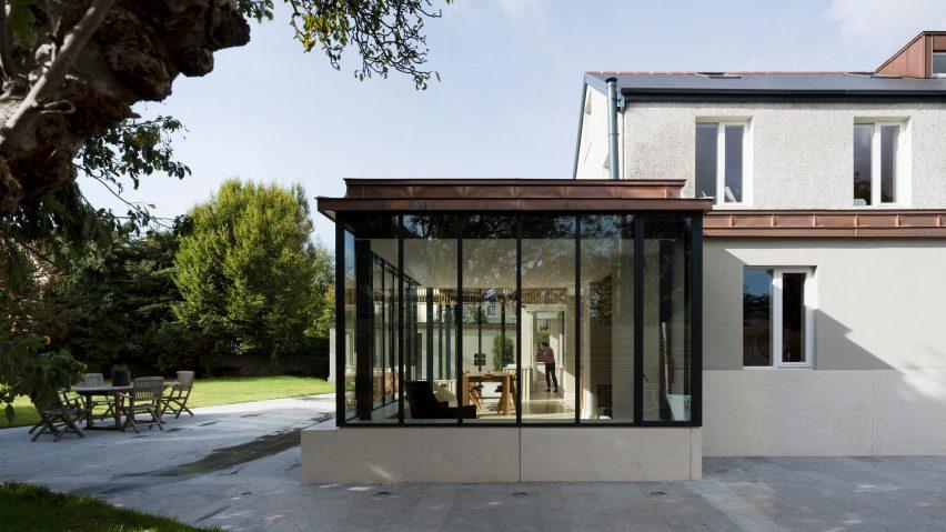 Glazed sun room with copper parapet extends Dublin house