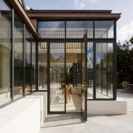 Glazed sun room with copper parapet extends Dublin house