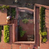 TAA Design tops red house in Vietnam with a stepped vegetable garden