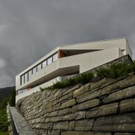 Angular outdoor terraces and feature staircase define house in Norway