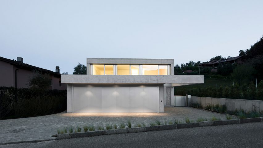 Colonnade extends from concrete house on an old vineyard in Switzerland