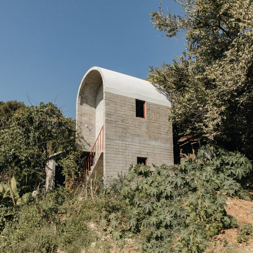 Vaulted concrete roof tops brick house Casa Martha by Naso