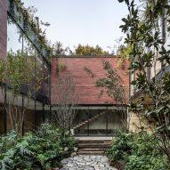 Monolithic brick volumes hide courtyard in Esrawe Studio's Casa Sierra Fría