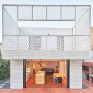 Bonba Studio encases extension in Barcelona in white metal mesh