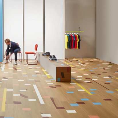 Vinyl Allura tiles mimic the look of a reclaimed gym floor