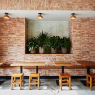 Terracotta brick and stucco create rustic aesthetic in Mexican restaurant Loqui