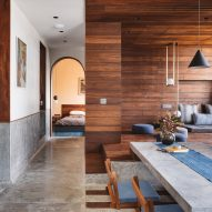 Sārānsh combines concrete, blue tiles and teak inside India's MD Apartment