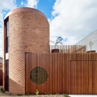 Brick and copper turrets define Melbourne house by Wowowa