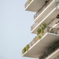 Irregular balconies surround social housing stacked over school in Paris