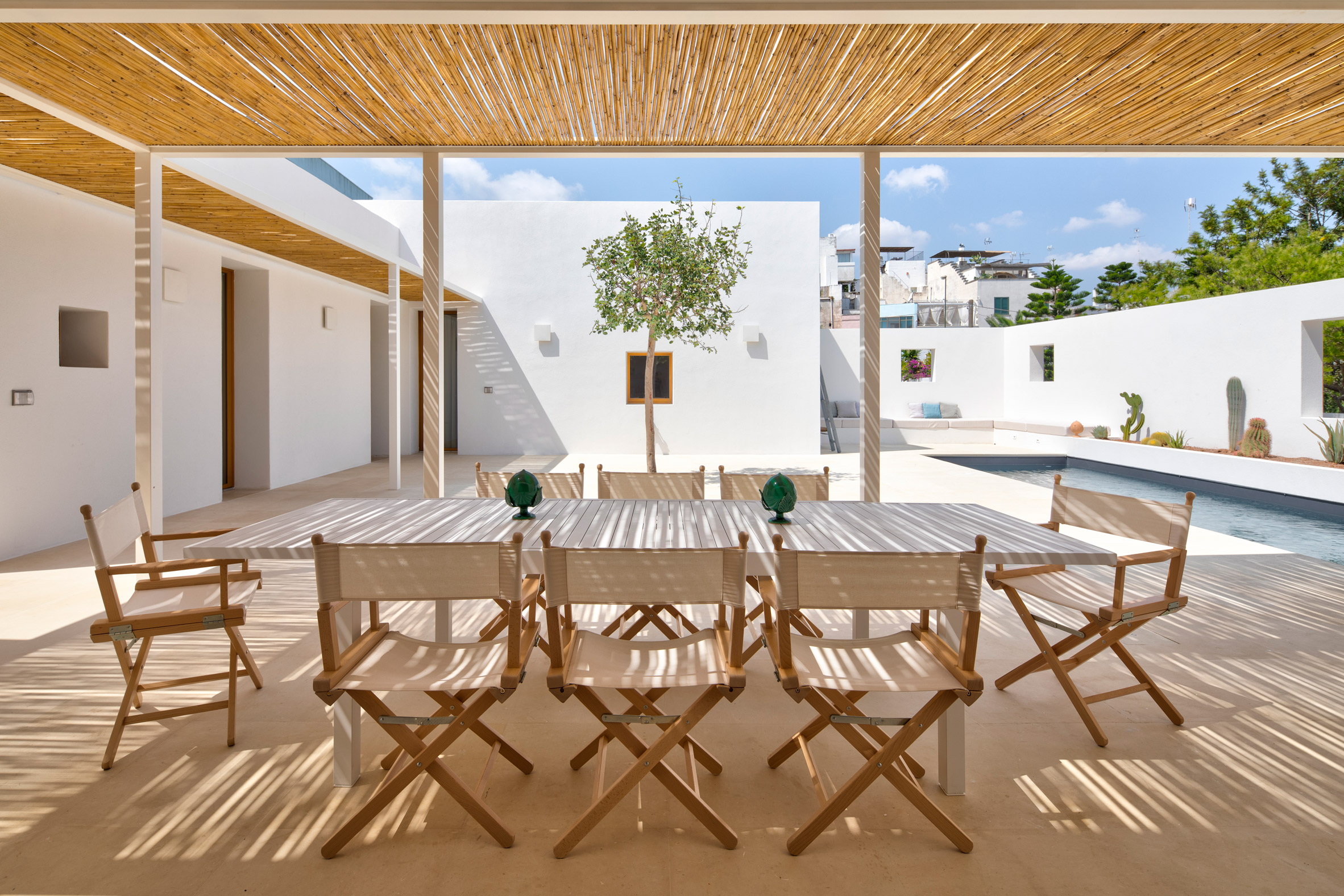 Sunny dining spot in Puglia house with white walls