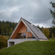 Pavel Míček Architects sinks house into a hillside in Czech mountains
