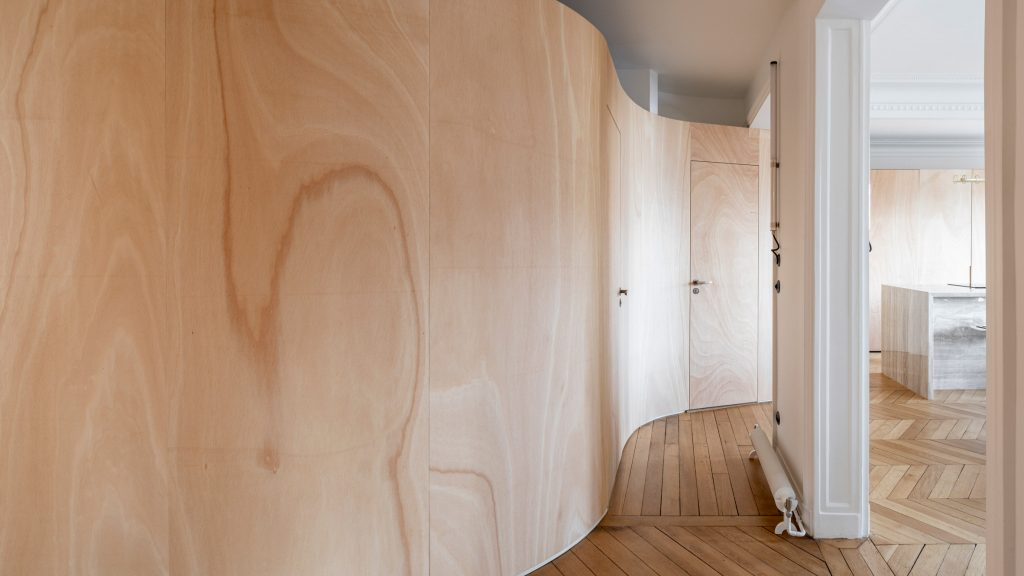 Wood Ribbon apartment in Paris features an undulating timber wall