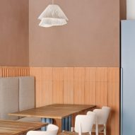 Cristina Celestino uses plaster and terracotta for 28 Posti restaurant interior