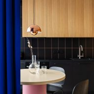Ater Architects uses blue curtains as walls in Kyiv apartment