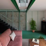 Ottotto remodels Portuguese home with panels of green metal mesh