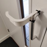 Architectural designers develop hands-free door handle to prevent spread of coronavirus