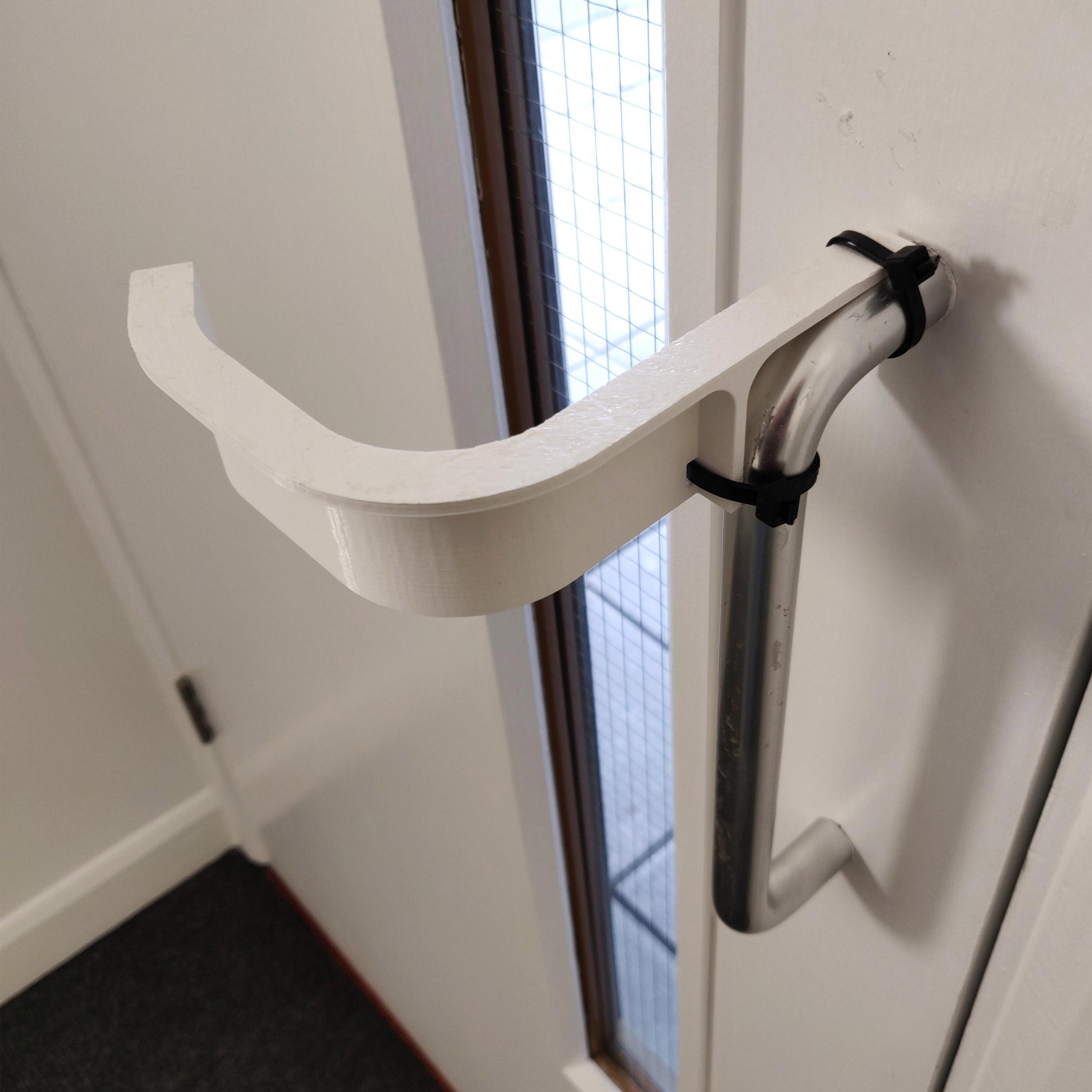 Hands-free door handle adaptor by Ivo Tedbury and Freddie Hong