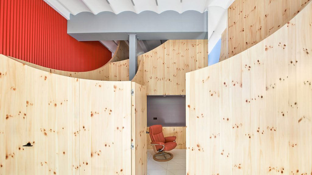 Impress dental clinic in Barcelona features smile-shaped timber partitions