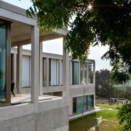 White concrete house by Matra Architects perches above lake in Udaipur