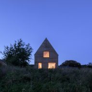 Steep gable defines barn-style house in rural England by Elliott Architects