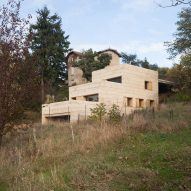Tectoniques sets ochre-coloured concrete house into French hillside