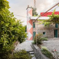 Fala Atelier adds colourful shower tower to small granite house
