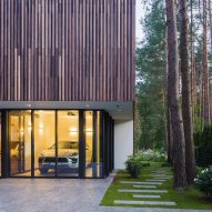 Smilgu House in Lithuania has a glass garage to display its owner's car