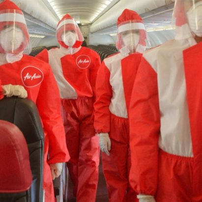 Puey Quinones designs PPE cabin crew uniform for AirAsia