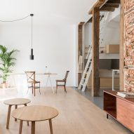 Original beams and brickwork add warmth to pared-back Madrid apartment