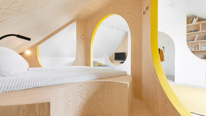 Bed in a renovated attic in Belgium