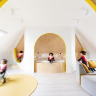 Van Staeyen Interieur Architecten refreshes Antwerp attic with pops of yellow