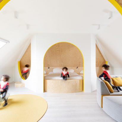 Van Staeyen Interieur Architecten refreshes Antwerp attic with pops of yellow