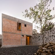 Escobedo Soliz wraps brick house for retired teacher around a patio