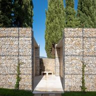 Microscape uses stone-filled cages to update Italian cemetery