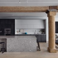 Worrell Yeung contrasts wood pillars and grey marble in Chelsea Loft