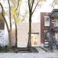 "TBA adds pale brick volume to traditional Montreal ""shoebox"" home"