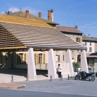 Elisabeth Polzella creates structural-stone covered market in Lamure-Sur-Azergues