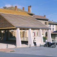 Elisabeth Polzella creates structural-stone covered market in Lamure-Sur-Azergues