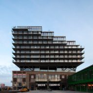 Mei Architects perches Fenix I apartments on dockside warehouse in Rotterdam