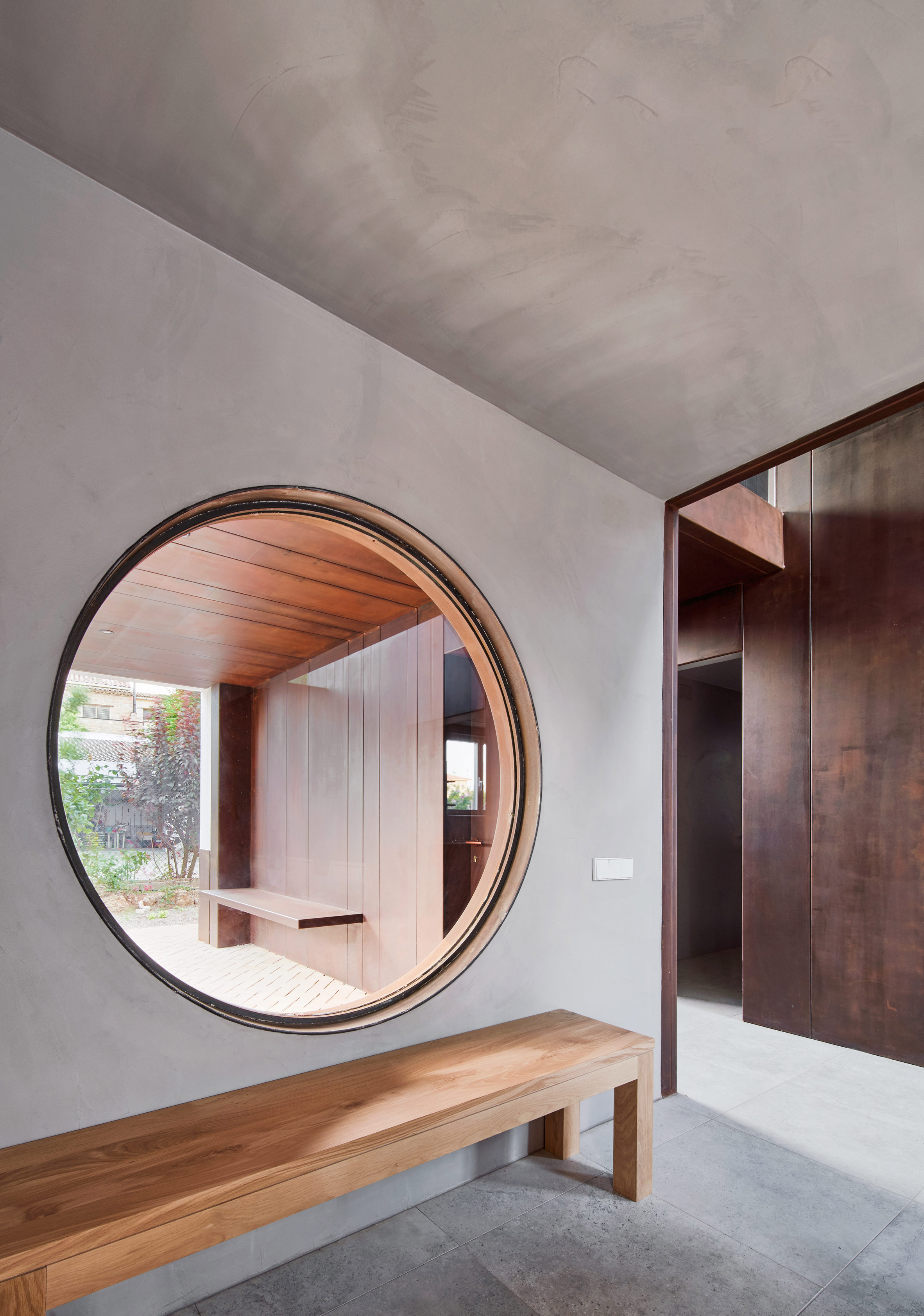 Gallery House by Raúl Sánchez Architects circular window