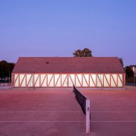 Lemoal Lemoal Architectes builds translucent half-timbered tennis pavilion