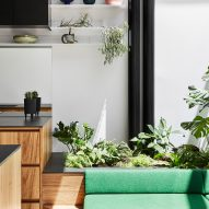 Green bench seat in the dining space